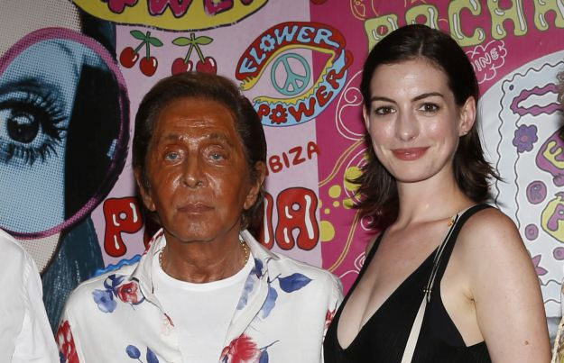 US actress Anne Hathaway, Italian designer Valentino Garavani, Giancarlo Giammetti, Spanish model Jon Kortajarena and some friends, attend Flower Power Party at Pacha Ibiza. Pictured: Anne Hathaway, Valentino Garavani, Giancarlo Giammetti, Jon Kortajarena Ref: SPL1100228  110815   Picture by: Splash News Splash News and Pictures Los Angeles:310-821-2666 New York:	212-619-2666 London:	870-934-2666 photodesk@splashnews.com